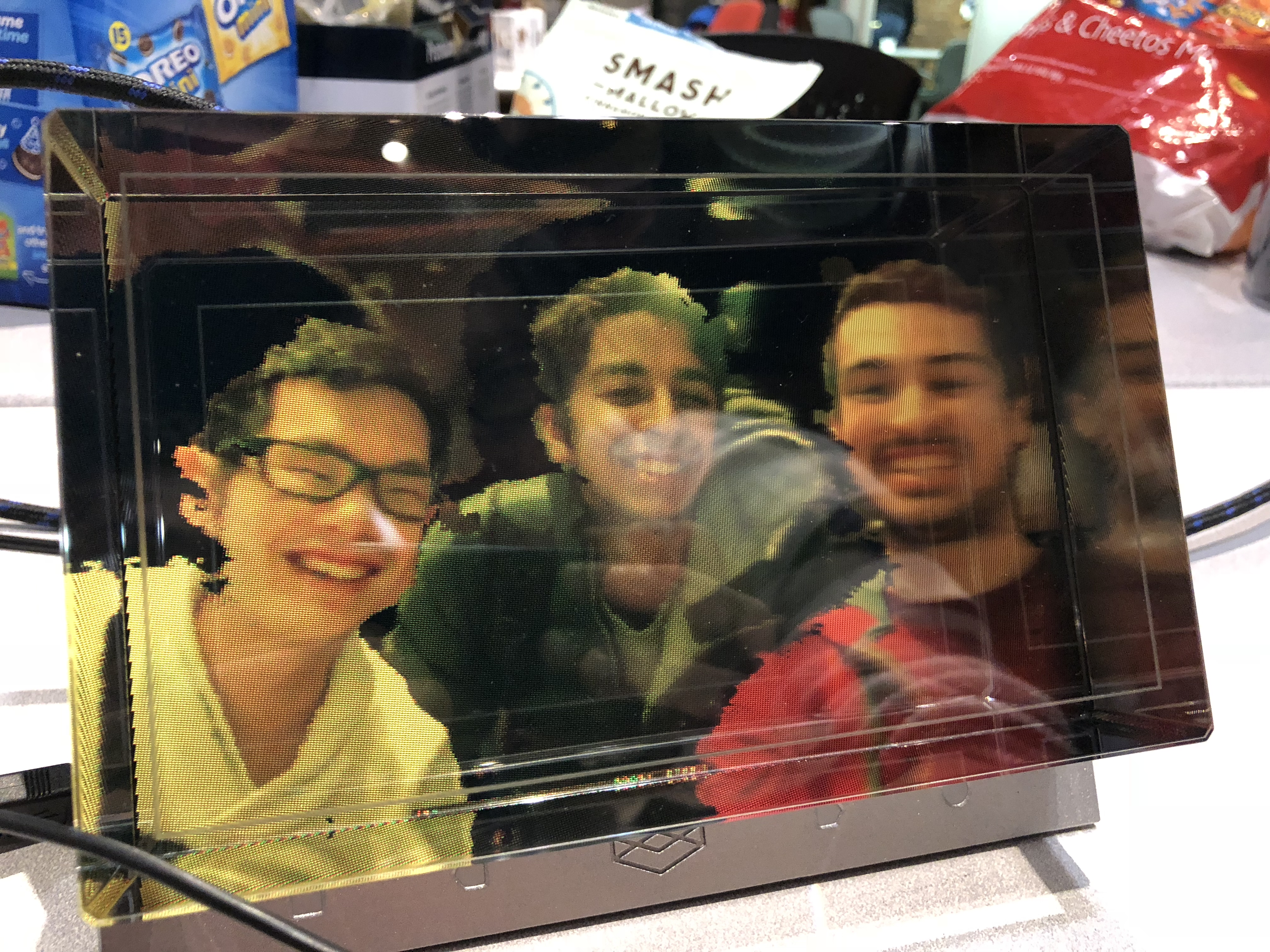 Photo of a holographic display with Phillip, Cyrus and Kumail in it